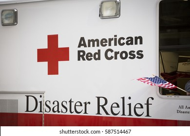 NEW YORK - 11 NOV 2016: American Flag waves in the window of an American Red Cross Disaster Relief truck in Americas Parade up 5th Avenue on Veterans Day in Manhattan.