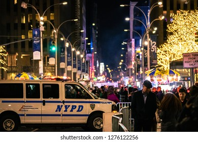 New York, New York - 12/24/2018 : NYPD police van blocking a road in Manhattan as the streets are filled with people waiting for a Christmas light show.
