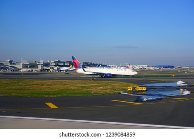 NEW YORK -17 NOV 2018-  View of an airplane from Delta Airlines (DL), a member of the Skyteam alliance, at the John F. Kennedy International Airport (JFK).