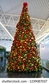 NEW YORK -17 NOV 2018- View of  a giant Christmas tree decorated with holiday ornaments in the American Airlines (AA) terminal 8 at the John F. Kennedy International Airport (JFK).