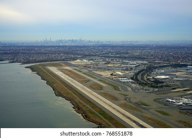 NEW YORK -18 NOV 2017-  Aerial view of the John F. Kennedy International Airport (JFK) with the New York City skyline in the background.
