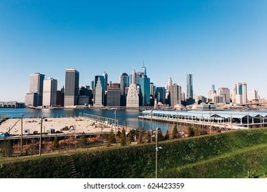 NEW YORK - 21 DECEMBER, 2016: Panoramic View of Lower Manhattan Skyline from Brooklyn Bridge Park