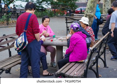 New York - 21 October 2017. People play mahjong in Colombus Park in Chinatown