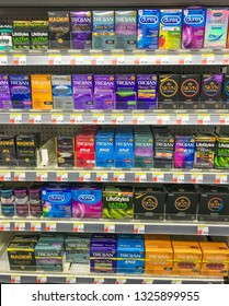 New York, 2/27/2019: Packs of various condoms stand on a shelf of a Walgreens drug store.