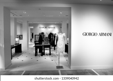 New York, 3/11/2019: Male employee is working at the Giorgio Armani section at Bloomingdale's department store in Manhattan.
