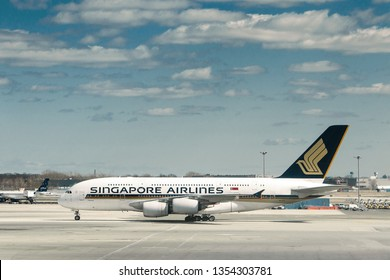New York, 3/17/2019: Singapore Airlines commercial jet is maneuvering on the tarmac at JFK airport.