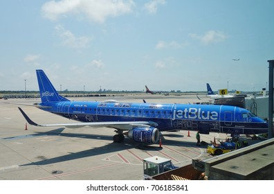 NEW YORK -4 AUG 2017-  An airplane from JetBlue (B6) painted with a special Blueprint livery at the John F. Kennedy International Airport (JFK). Jet Blue is headquartered in Long Island City.
