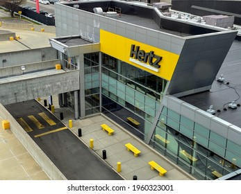 New York, 4-16-2021: The front of the Hertz car rental location at the JFK airport.