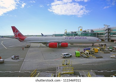 NEW YORK -6 JUN 2018- View of an airplane from Virgin Atlantic outside of Terminal 4 at the John F. Kennedy International Airport (JFK).