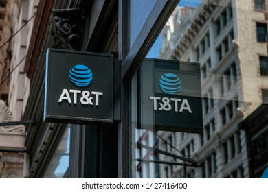 New York, 6/15/2019: AT&T store sign is reflected in the window along with a building across the street.