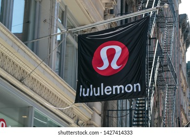 New York, 6/15/2019: Lululemon banner is flying above the entrance to their store in SoHo.