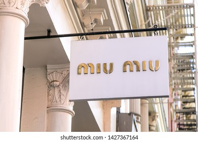 New York, 6/15/2019: Miu Miu banner is suspended near the entrance to their store  in SoHo.