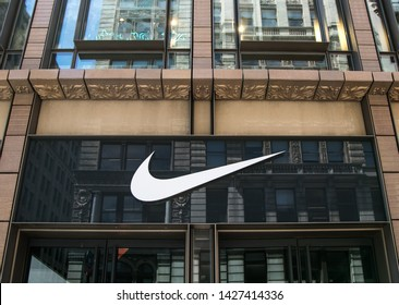 New York, 6/15/2019: Nike's logo is displayed above the entrance to their store in SoHo.