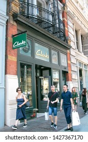 New York, 6/15/2019: People walk by a Clark's store in SoHo.