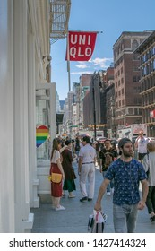 New York, 6/15/2019: People walk by a Uniqlo store in SoHo.