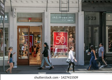 New York, 6/15/2019: People walk by an Intimissimi store in SoHo.