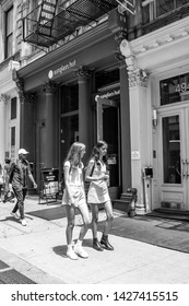 New York, 6/15/2019: People walk by a Sunglass Hut store in SoHo.