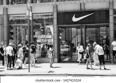 New York, 6/15/2019: People walk by a Nike store in SoHo.