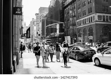 New York, 6/15/2019: People walk along Brodway near Spring Street on a Saturday afternoon.