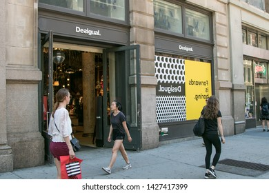 New York, 6/15/2019: People walk by a Desigual store in SoHo.