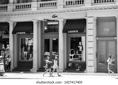 New York, 6/15/2019: People walk by a Lacoste store in SoHo.