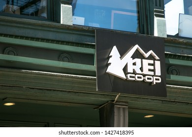 New York, 6/15/2019: REI co-op sign is mounted above the entrance to their store in SoHo.