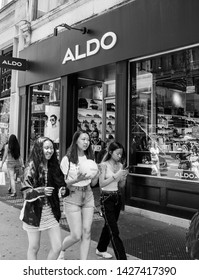 New York, 6/15/2019: Three young females walk by an ALDO store in SoHo.