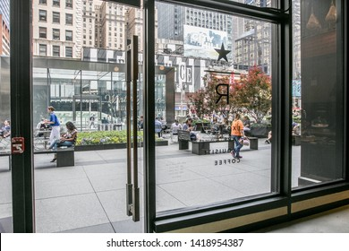New York, 6/6/2019: The scene on Broadway in midtown Manhattan as seen from inside a Starbucks Reserve coffee shop.