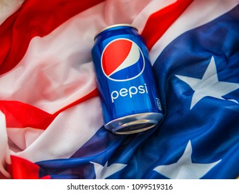 NEW YORK, AMERICA - NOVEMBER 29, 2016: metal can of pepsi cola lie in wooden box, case on american flag