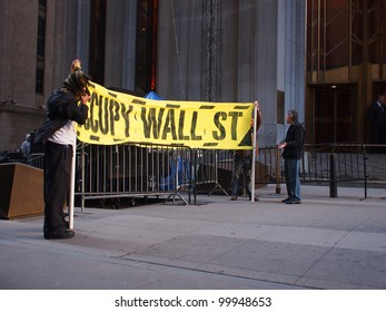 NEW YORK - APR 13: Occupy Wall Street activists hold a banner on Wall Street April 13, 2012 in New York City, NY. Protesters continued their months-long demonstration against the financial system.