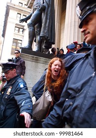 NEW YORK - APR 13: An unidentified Occupy Wall Street activist is arrested on the steps of Federal Hall on Wall Street April 13, 2012 in New York City, NY.