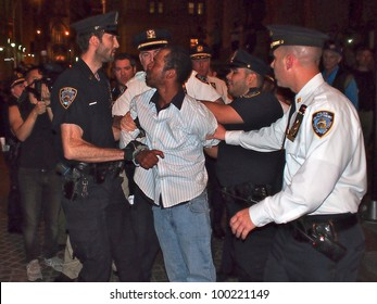 NEW YORK - APR 16: Police arrest an unidentified man at an Occupy Wall Street rally, April 16, 2012 in New York City. Demonstrators were holding a protest on the steps of Federal Hall.