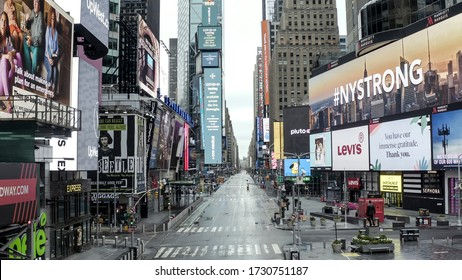 NEW YORK - APR 25, 2020: empty Times Square city street with NY STRONG billboard giving hope during coronavirus COVID-19 pandemic lockdown - nobody outside in Manhattan NYC.