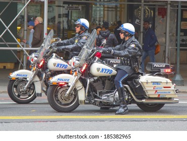 NEW YORK - APRIL 1: NYPD officers on motorcycles providing security in Manhattan on April 1, 2014. New York Police Department, established in 1845, is the largest police force in USA