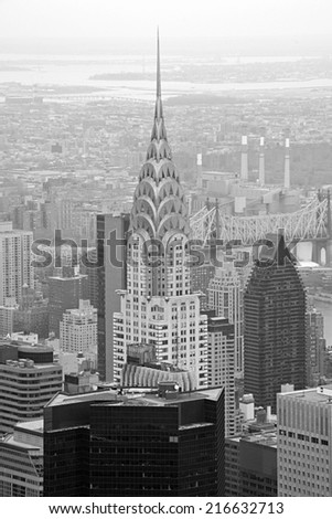 NEW YORK - APRIL 10: A captivating aerial view of the Chrysler Building, Manhattan skyscrapers and buildings from the top of the Empire State Building in black and white on April 10, 2011.