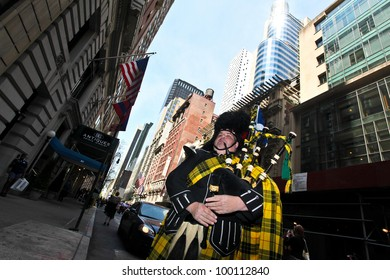 NEW YORK - APRIL 14:  A man dressed in Scottish Kilt practices his Bag Pipes before The Scotland Week Parade on 6th Avenue April 14, 2011 in New York, NY.