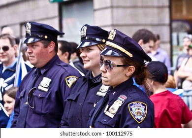 NEW YORK - APRIL 14:  Three officers of The NYPD watch as The Scotland Week Parade on 6th Avenue continues on April 14, 2011 in New York, NY.