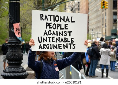New York, New York. - April 15, 2017: People carrying signs at the March for Science in Manhattan in 2017 in New York City.