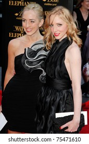 """NEW YORK - APRIL 17:  Victoria Pattinson and Lizzy Pattinson attend the premiere of """"Water for Elephants"""" at the Ziegfeld Theatre on April 17, 2011 in New York City."""