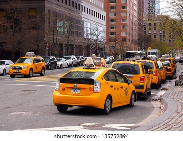 NEW YORK - APRIL 20: A taxi line in Battery Park City, Manhattan, April 20, 2013 in New York City. The city is planning to replace its fleet of various kinds of taxis with one model.