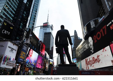 NEW YORK, NEW YORK - APRIL 2017: A silhouetted stature of George M. Cohan seems to look out over Times Square in New York City.