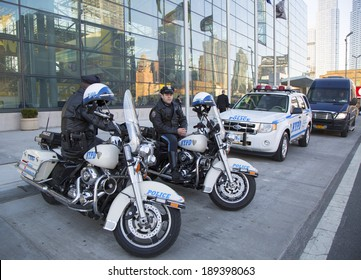 NEW YORK - APRIL 24: NYPD highway patrol officers on motorcycles providing security in Manhattan on April 24, 2014. New York Police Department, established in 1845, is the largest police force in USA