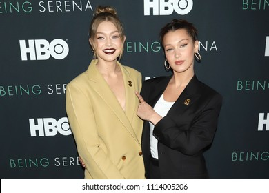 "NEW YORK - APRIL 25, 2018: Gigi Hadid and Bella Hadid attend the premiere of ""Being Serena"" at the Time Warner Center on April 25, 2018, in New York City."