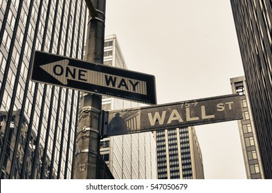 NEW YORK - APRIL 27, 2016: Vintage street sign of wall street in downtown manhattan