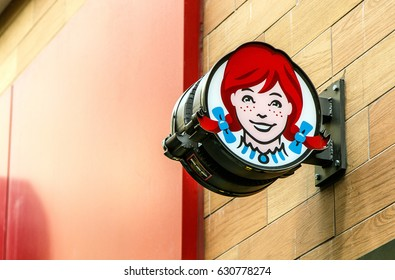 New York, April 28, 2017: The sign above an entrance to a Wendy's fast food restaurant in downtown Manhattan.