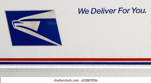 New York, April 28, 2017: Closeup of a side of a USPS truck with the service's logo and motto.