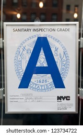 NEW YORK - APRIL 3: Sanitary Inspection Grade posted in a window of Shake Shack in New York, New York on April 3, 2012. Such signs are displayed in all restaurants.