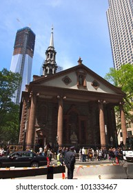 NEW YORK - APRIL 30: One World Trade Center rises behind St. Paul's Chapel April 30, 2012 in New York City. The skyscraper became the tallest building in New York April 30.