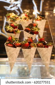 NEW YORK - APRIL 4, 2017: Dark Chocolate Dipped Strawberries by Godiva on display in Macy's Herald Square. Godiva Chocolatier is a manufacturer of premium chocolates founded in Belgium in 1926.
