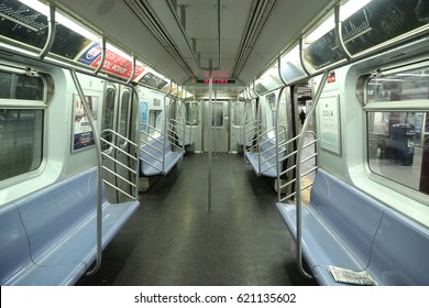 NEW YORK - APRIL 4, 2017: Inside of NYC Subway Car at Eighth Avenue Station in Manhattan. Owned by the NYC Transit Authority, the subway system has 469 stations in operation